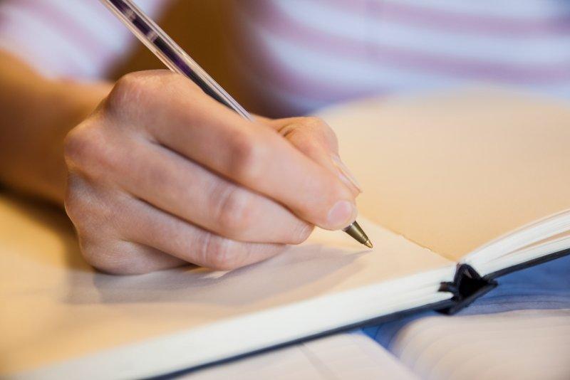 female-student-writing-notes